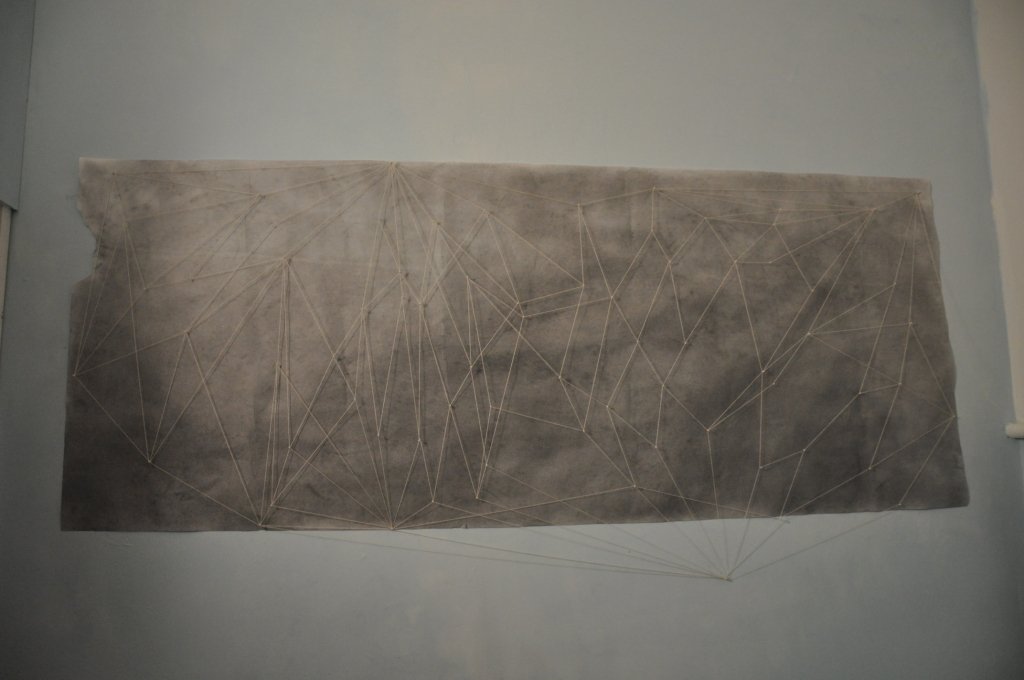Title: Blind Line Drawing Series: Faint Visions Dimensions: 2.5'x6' Materials: Paper, Graphite, String, Pins Description: Drawing made blindfolded (Graphite, pins) then string placed with no blindfold on.