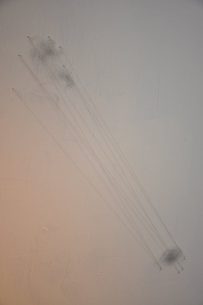 Title: Faint Drawing One Materials: Graphite powder, pearl pins, and white string on drywall.